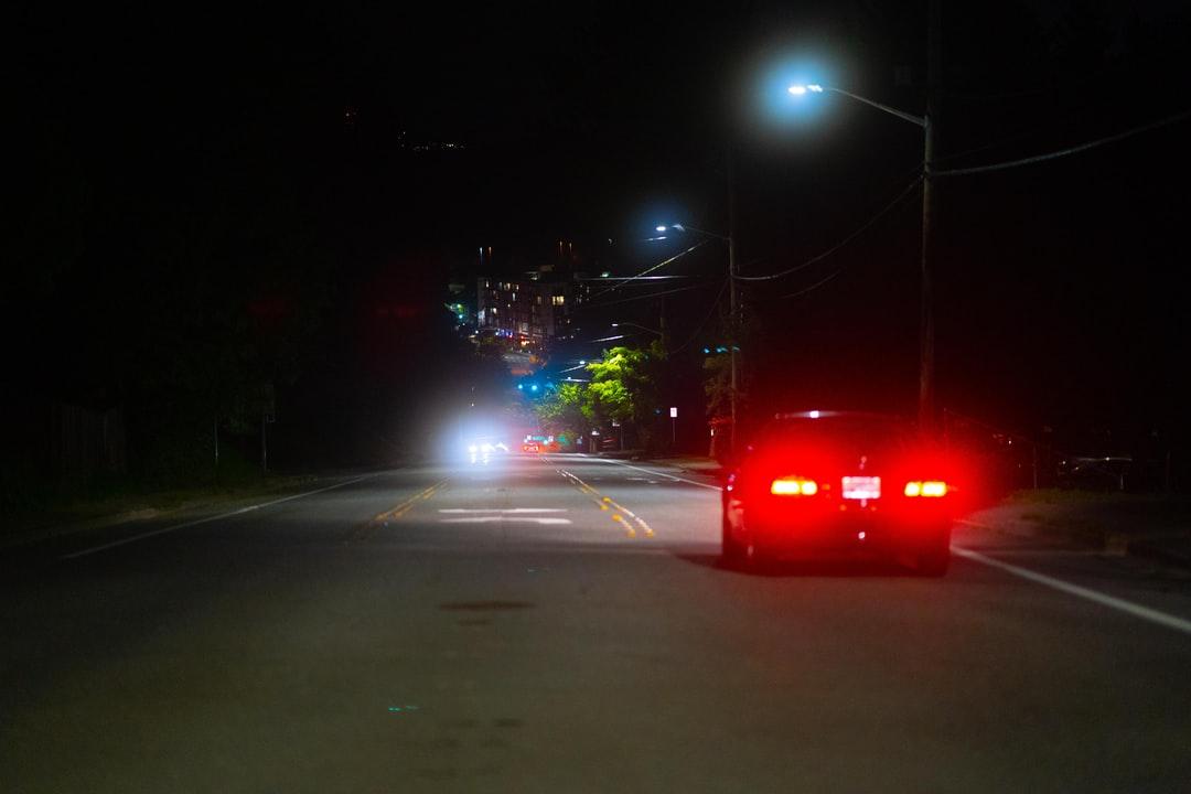 A traffic light at night